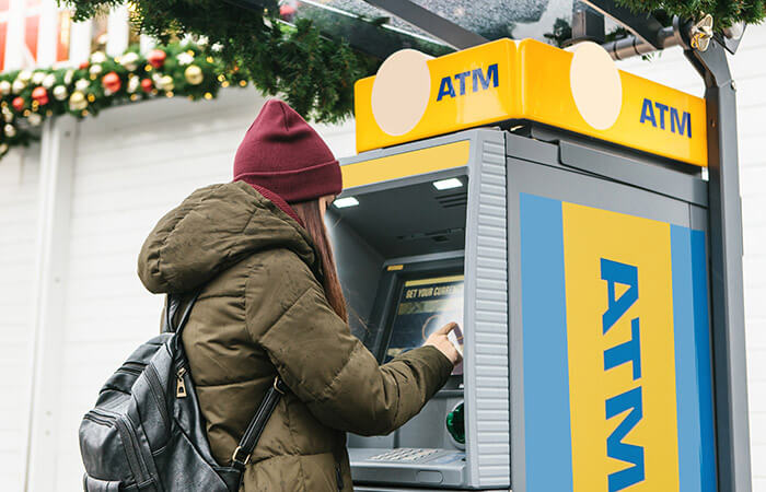 woman using ATM in Prague