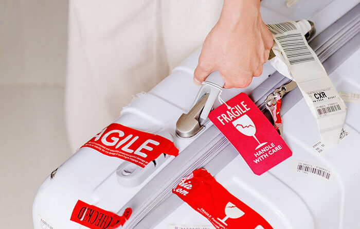 baggage with fragile sticker