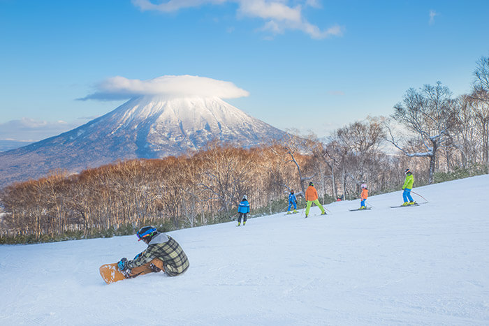 People skiing on the snow slope
