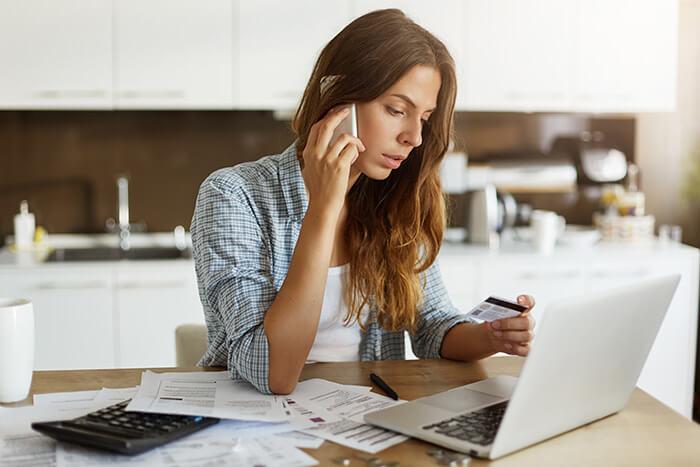 Woman calling bank
