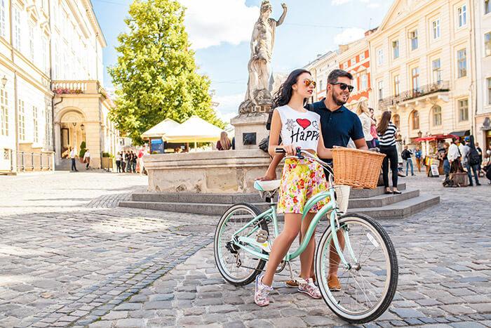 couple walking with bicycle