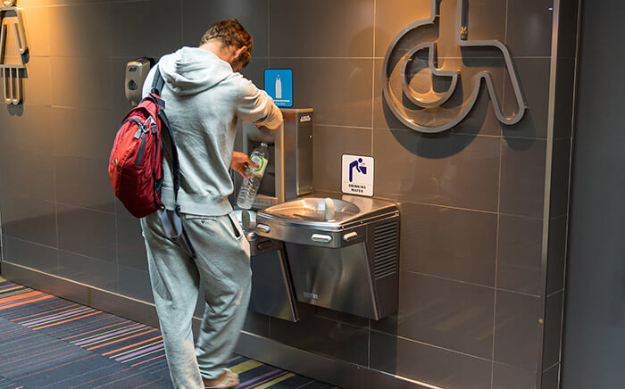 man filling drinking water