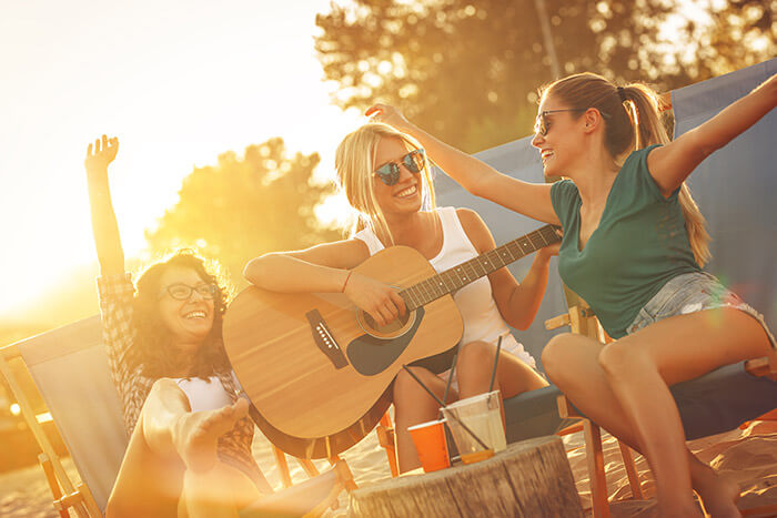 group of friends playing guitar