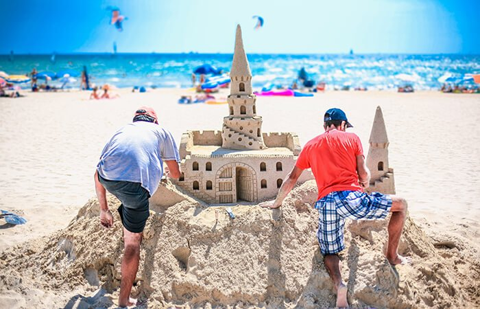 Sandcastle Lessons On The Beach